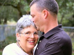 son kissing top of mom's head with mother message
