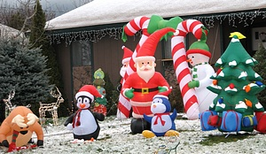Christmas inflatables decorating house lawn covered with snow