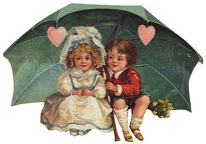 Boy and girl under Valentine umbrella with hearts.