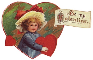 Girl holding heart that says