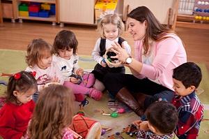 teacher plays with preschoolers
