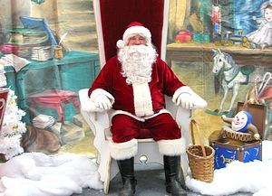 Store Santa sitting on gold throne