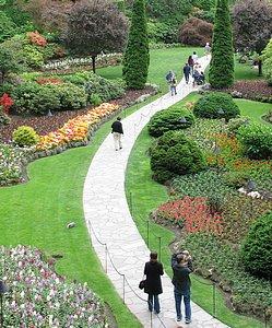 A walk in the garden for mother. Concrete path through Butchart Gardens in Victoria, B.C.