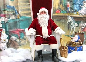Store Santa sitting on gold throne