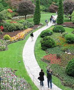 A walk in the garden for mother. Concrete path through Butchart Gardens in Victoria, B.C.